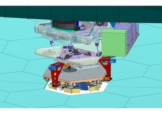 The Segment Handling System (SHS) and its precision robotic hand, which traverses under the bridge (inset)