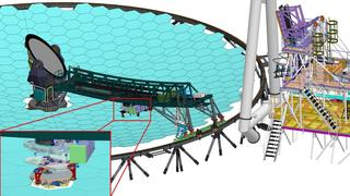 The segment handling system %28shs%29 and its precision robotic hand  which traverses under the bridge.